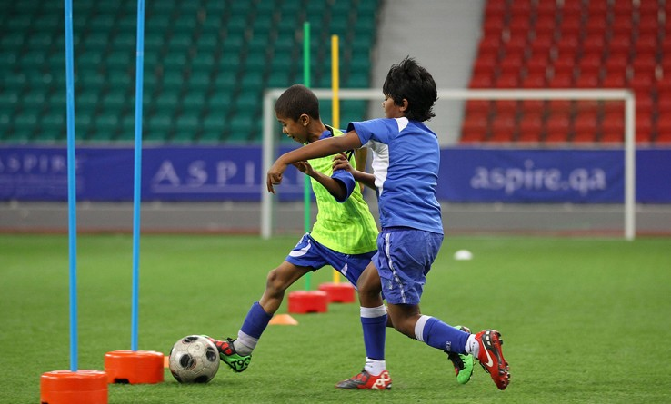 DOHA, QATAR - JANUARY 25:  Local children participate in a football training session at the ASPIRE Academy for Sports Excellence on January 25, 2011 in Doha, Qatar.  (Photo by Robert Cianflone/Getty Images)