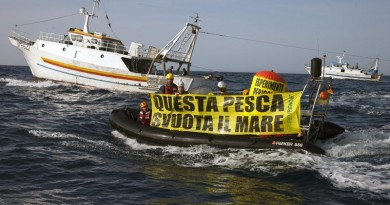 "Greenpeace activists hold a banner reading in Italian ""This Fishery Empties The Sea"" in front of the 'Santo Padre' and 'Ardito' pair trawlers. The action is to denounce unsustainable fishing in the Mediterranean, in the Strait of Messina. Greenpeace is on a European tour to support and promote sustainable fishing as a vital part in the current reform of the European Common Fisheries Policy."
