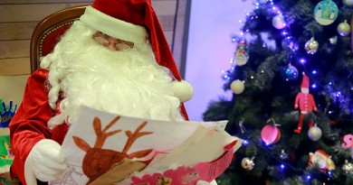 A man dressed as Santa Claus reads Christmas letters sent by children at the Libourne's post office, southwestern France, on December 18, 2015. A special unit of La Poste, which opened in 1962, employs each year around 60 people to answer letters by children from 140 countries.  / AFP / NICOLAS TUCAT        (Photo credit should read NICOLAS TUCAT/AFP/Getty Images)