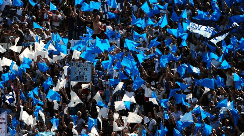 SSC Napoli's supporters cheer their team during their Serie A football match against FC Bologna at Dall'Ara stadium in Bologna on April 10, 2011.  AFP PHOTO / TIZIANA FABI (Photo credit should read TIZIANA FABI/AFP/Getty Images)