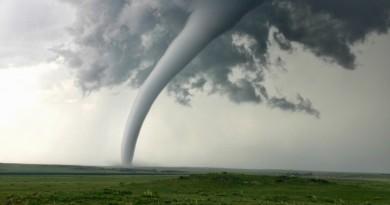 Tornado column in rural landscape